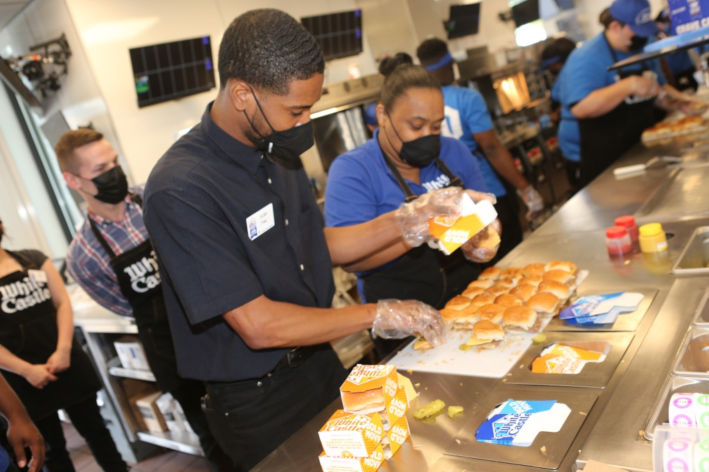 Employees prepare sliders together at White Castle Orlando.